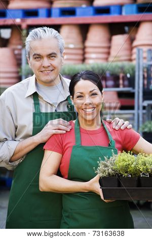 Hispanic couple working at garden center