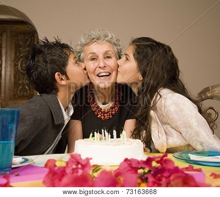 Senior woman celebrating birthday with grandchildren