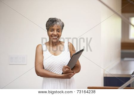 Senior African businesswoman holding paperwork