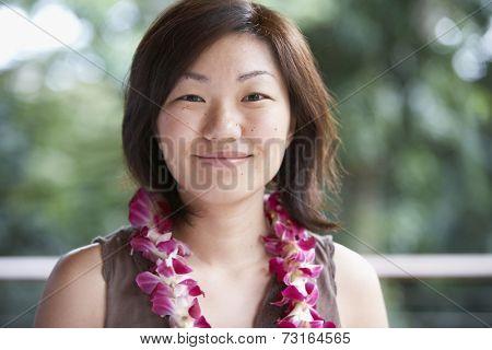 Asian woman wearing lei