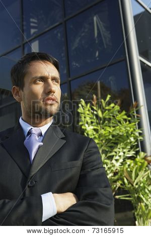 South American businessman with arms crossed