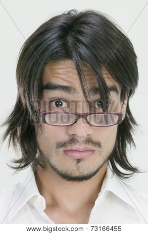 Young Hispanic man wearing eyeglasses