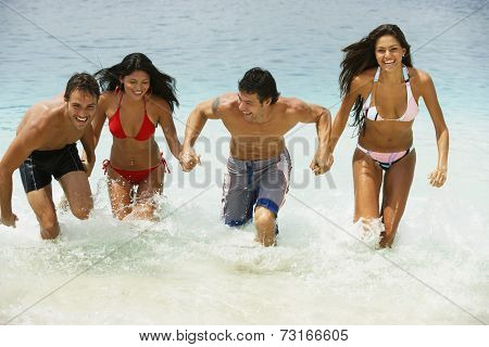 South American couples running in water