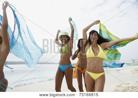 South American women running on beach