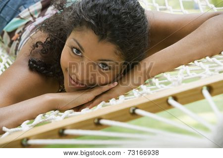 African American woman laying in hammock