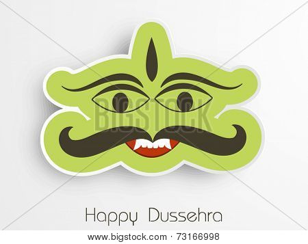 Illustration of Ravana face in funny way for sticker with Happy Dussehra text.