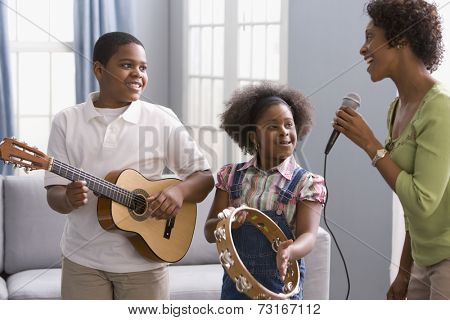 African American mother and children playing instruments