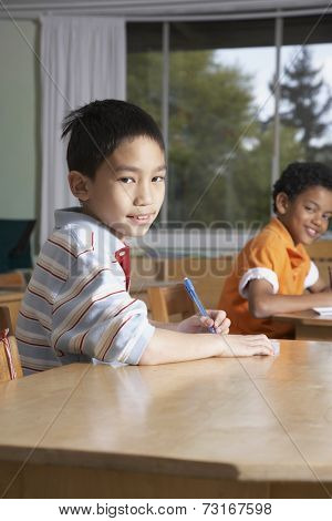Multi-ethnic boys in classroom