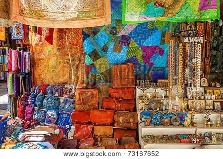 JERUSALEM, ISRAEL - JULY 10, 2014: Gift shop on bazaar in Old City of Jerusalem with variety of middle east traditional souvenirs. It is very popular with tourists and pilgrims visiting Holy Land.
