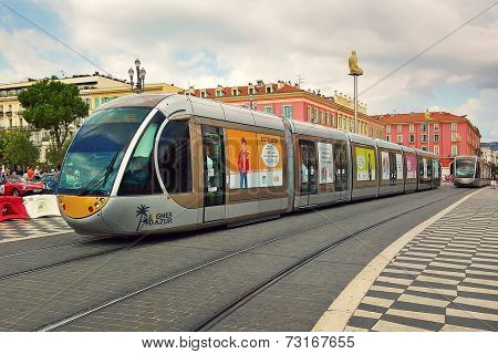 NICE, FRANCE - SEPTEMBER 12, 2014: Contemporary tram passing on Place Massena - one of the main city squares, place for carnivals, concerts, parades, traditional celebrations and other public events.
