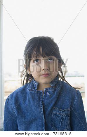 Hispanic girl looking up