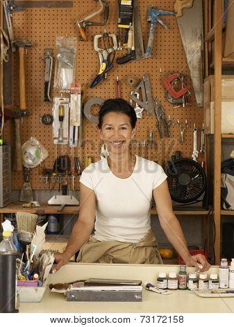 Eurasian woman in woodworking shop