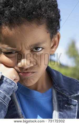 Close up of Mixed Race boy frowning