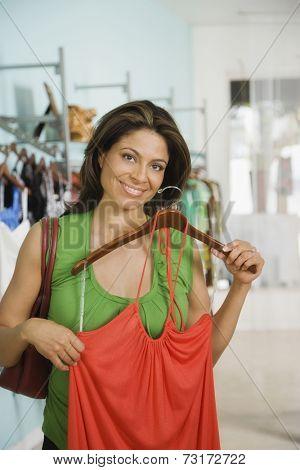 Hispanic woman shopping in clothing store