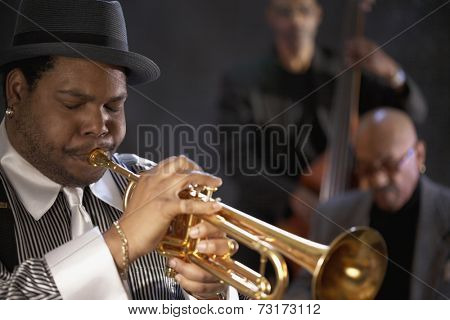 African man playing trumpet