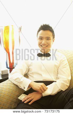 Asian man wearing bowtie