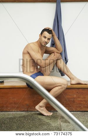 Mixed Race man wearing bathing suit