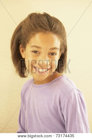 Close up of African American girl smiling