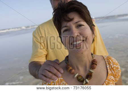 Hispanic woman in front of husband