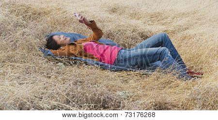 Asian woman listening to mp3 player