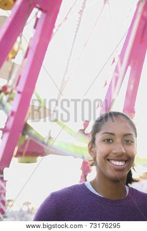 African American girl in front of Ferris wheel