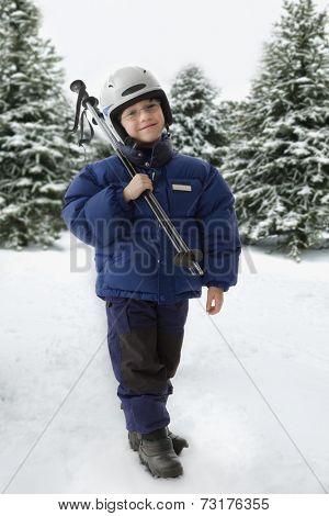 Mixed Race boy holding ski poles