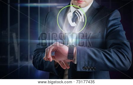Composite image of businessman using hologram watch against office overlooking city at night