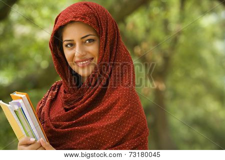 Indian woman holding school books