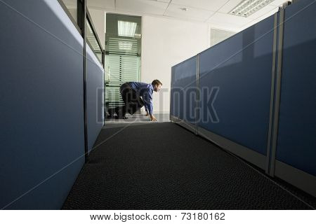 Businessman sneaking out of the office