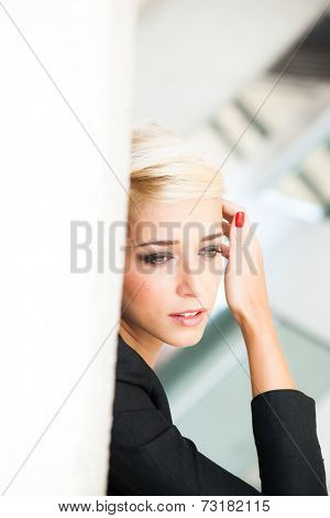 elegant  short blonde hair woman in black blazer city  outdoor portrait