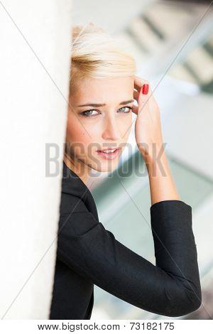 elegant  short blonde hair woman in black blazer city  outdoor portrait