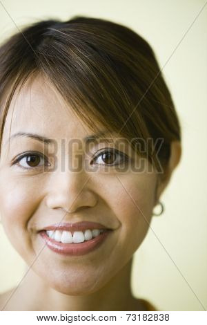 Close up of Pacific Islander woman smiling