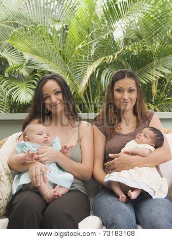 Hispanic mothers holding babies