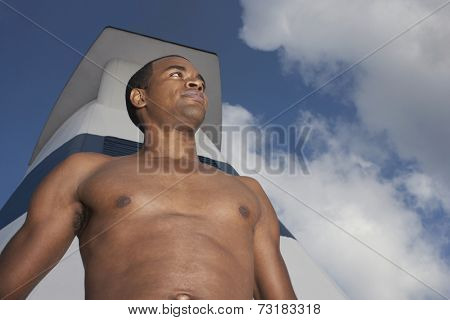 Low angle view of bare-chested African American man