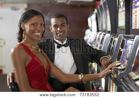 Couple next to slot machines