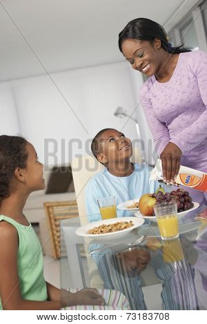 African American mother and children at breakfast