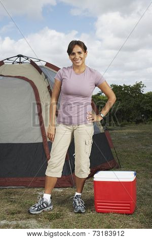 Hispanic woman in front of tent