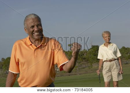 Senior African American couple on golf course