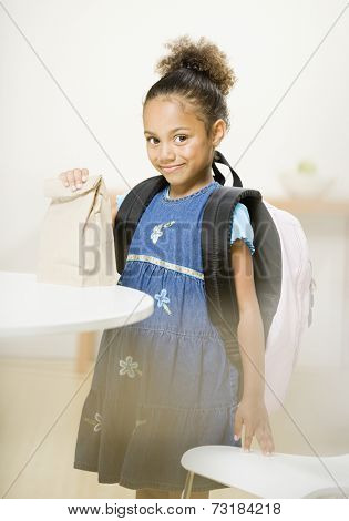 African American girl wearing backpack