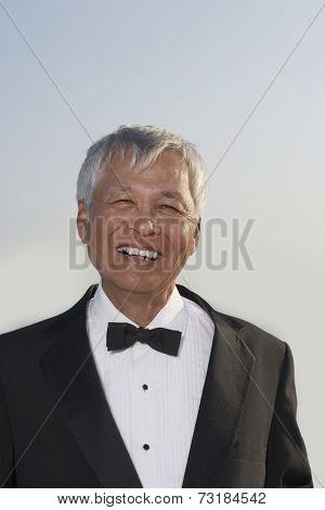 Senior Pacific Islander man wearing tuxedo