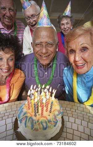 Senior Mixed Race man celebrating birthday