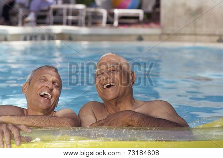 Multi-ethnic senior men in swimming pool
