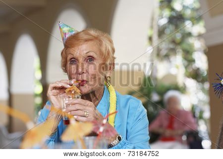 Senior woman drinking cocktail
