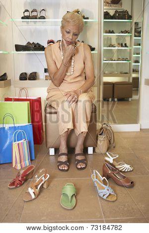 Senior African American woman shoe shopping