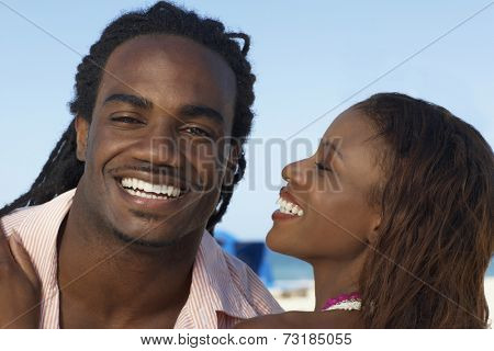 Hispanic woman smiling at boyfriend