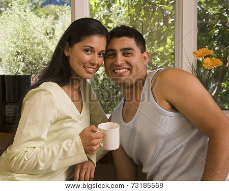 Multi-ethnic couple touching heads