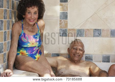 Multi-ethnic senior couple in hot tub