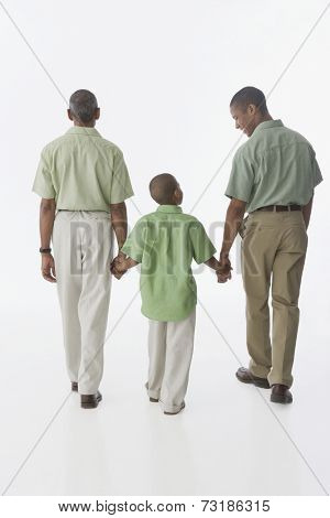 African American grandfather, father and son holding hands