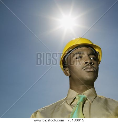 Low angle view of African American man wearing hard hat