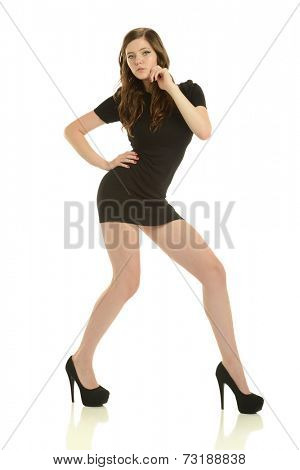 Young fashion model with black dress and heels on a white background